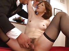 She is a sexy milf and has a pretty and slutty face that makes a guy horny and eager to fuck her pussy. The lustful looks she gives this guy makes him kiss her delicate lips and cunt. She keeps her thighs spread as he fingers and licks that hairy vagina with lust. This milf seems to be experienced, watch her!